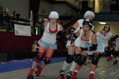 Gun'her Gombos jams while Evil Jenevil helps hold off a blocker. *photo by .00Buck